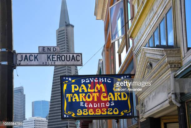 Visitors and residents of San Francisco, California, walk along sidewalk in the city's North Beach district. In the background is the landmark...