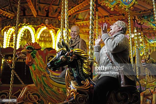 Visitors and shoppers enjoy the carousel during the Worcester Victorian Christmas Fayre on November 26 2015 in Worcester England Now in its 23rd year...