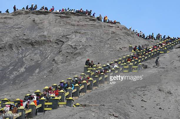 Visitors and Tengger tribe devotees belonging to Indonesia's Hindu minority ascend to the active crater of Mount Bromo volcano in East Java province...