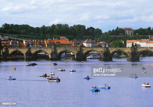 Visitors and tourists canoeing in on Vlatava River