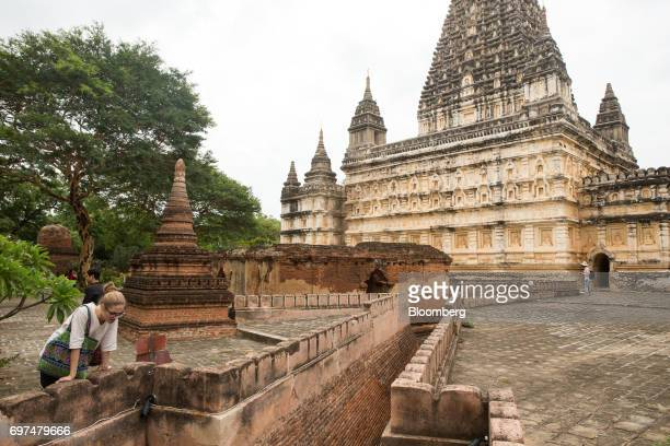 Visitors and tourists explore the grounds of a Buddhist temple in Bagan Myanmar on Saturday June 10 2017 When the country opened to the outside world...