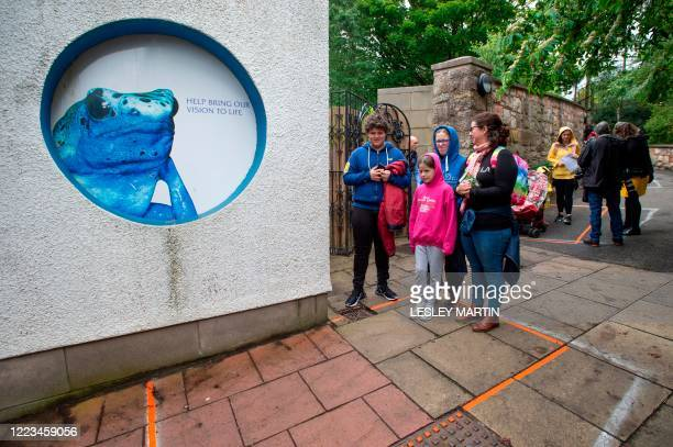 Visitors and tourists social distance as they queue to enter Edinburgh Zoo which re-opened in Edinburgh on June 29, 2020 as shops other non-essential...