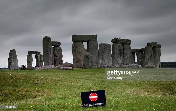 Visitors and tourists walk around the ancient monument at Stonehenge on July 14 2008 in Wiltshire, England. English Heritage, that manages the...