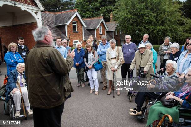 Visitors and World War II veterans are given a guided tour of Bletchley Park during an annual reunion event of veterans who worked at Bletchley Park...