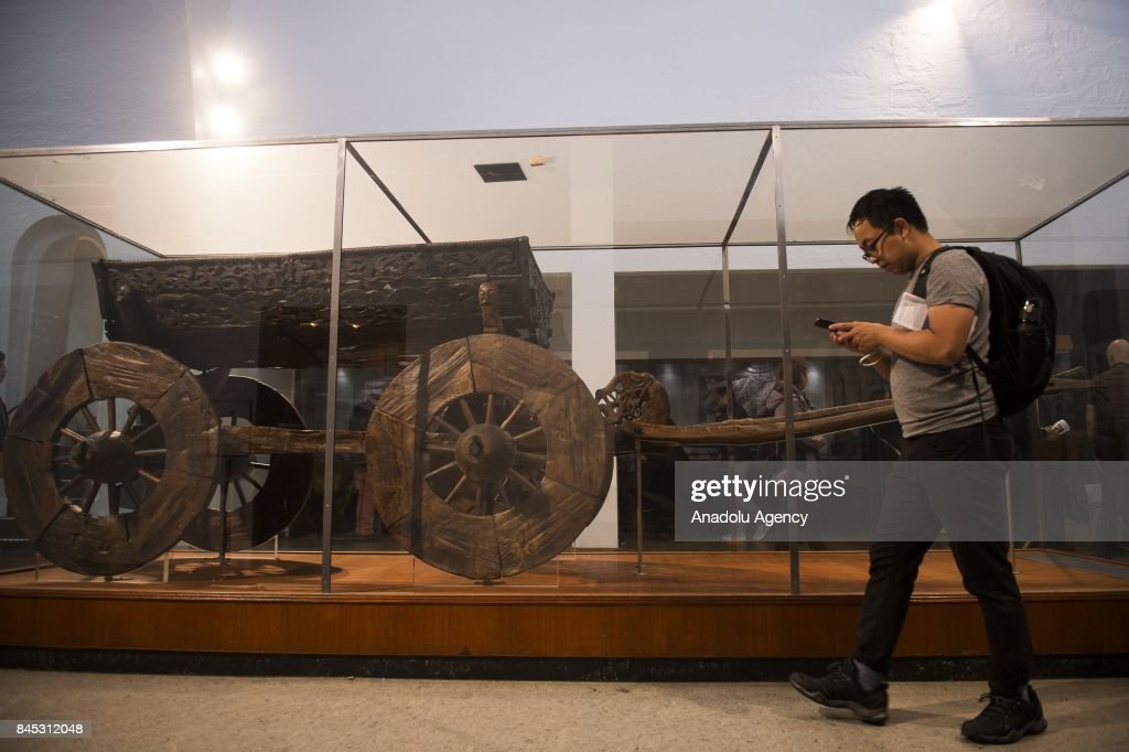 Visitors Appreciate Several Artifacts And Wagons Found During The Oseberg Ship Escavation At Viking