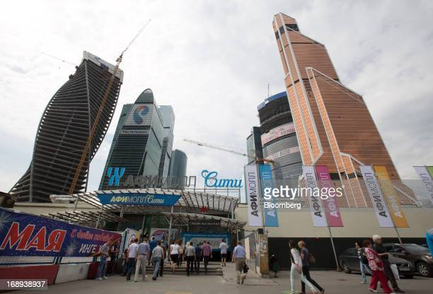 Visitors approach the Afimall City shopping and entertainment complex at 'Moscow City' business center in Moscow Russia on Friday May 17 2013...