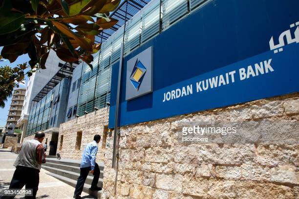 Visitors approach the entrance to the Jordan Kuwait Bank in Amman Jordan on Thursday June 21 2018 President Trump and First Lady Melania Trump will...
