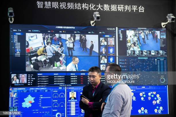 Visitors are filmed by AI security cameras using facial recognition technology at the 14th China International Exhibition on Public Safety and...