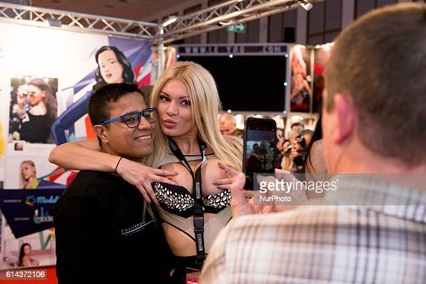 Visitors are pictured during the 20th Venus Erotic Fair in Berlin Germany on October 13 2016