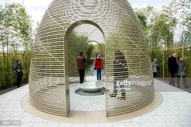 Visitors are pictured in the China 'Garden of solitary delight' during the opening of the IGA 2017 in Berlin Germany on April 13 2017 The exhibition...