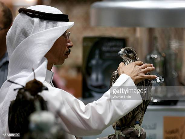 Visitors are pictured inspecting the falcon selection at Abu Dhabi National Exhibition Centre on September 9 2015 in Abu Dhabi United Arab Emirates