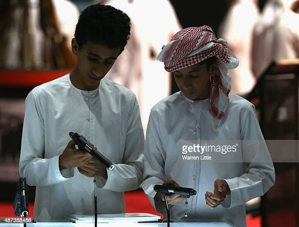 Visitors are pictured inspecting the handgun selection at Abu Dhabi National Exhibition Centre on September 9 2015 in Abu Dhabi United Arab Emirates