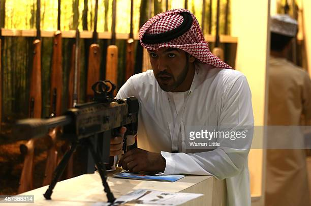 Visitors are pictured inspecting the rifle and handgun selection at Abu Dhabi National Exhibition Centre on September 9 2015 in Abu Dhabi United Arab...