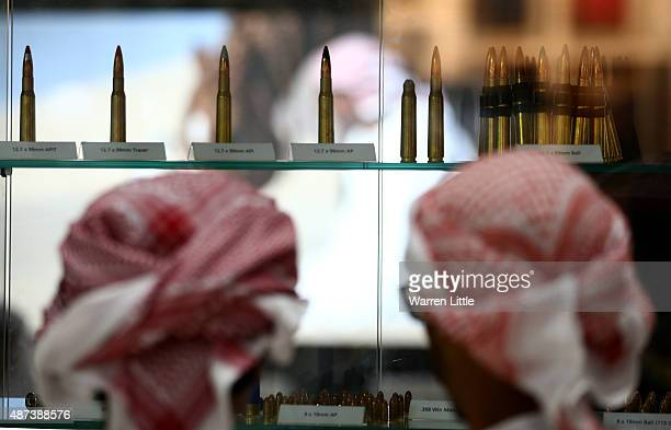 Visitors are pictured inspecting the rifle selection at Abu Dhabi National Exhibition Centre on September 9 2015 in Abu Dhabi United Arab Emirates