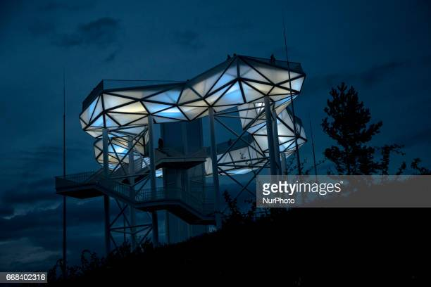 Visitors are pictured on the Wolkenhain at the blue hour during the opening of the IGA 2017 in Berlin Germany on April 13 2017 The exhibition will...