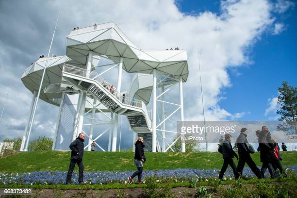 Visitors are pictured on the Wolkenhain during the opening of the IGA 2017 in Berlin Germany on April 13 2017 The exhibition will open from April 13...