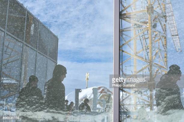 Visitors are reflected in a window at the aerial tramway summit station of the new 'Eibsee Seilbahn' cable car connection departs for the Zugspitze...