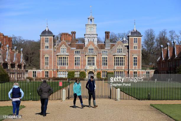 Visitors are seen at Blickling Hall and Estate, which has been closed by the National Trust to help fight the spread of coronavirus on March 22, 2020...