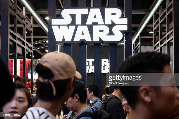 Visitors are seen at Disney's Star Wars booth during the Ani-Com & Games event in Hong Kong.