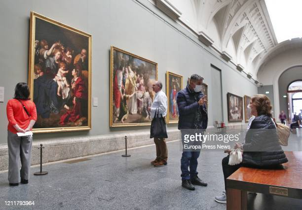 Visitors are seen at the central gallery of Prado Museum, that will not close but is taking measures against coronavirus outbreak on March 11, 2020...