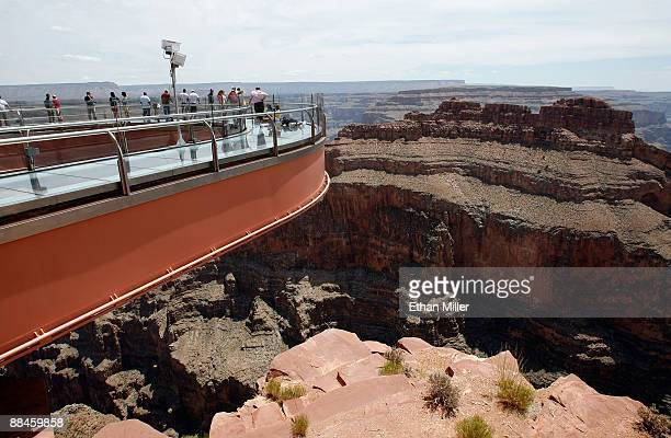 Visitors are seen at the Grand Canyon Skywalk June 12 2009 in Grand Canyon West Arizona The Skywalk is a oneofakind glass bottom cantilever bridge...