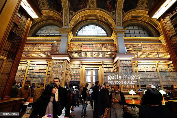 Visitors are seen at the library of the National Assembly in Paris on September 14 2013 during the 30th edition of France's European heritage open...