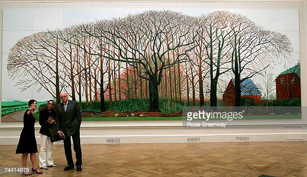 Visitors are seen beside artwork by David Hockney RA titled 'Bigger Trees Near Warter' at The Royal Academy of Arts 239th Summer Exhibition at the...