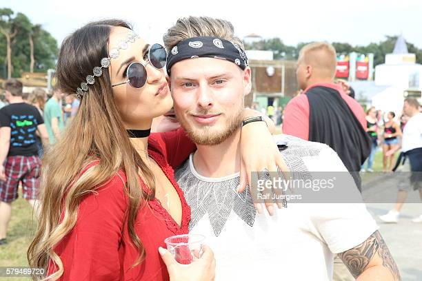 Visitors are seen during the ParookaVille Festival on July 15 2016 in Weeze Germany