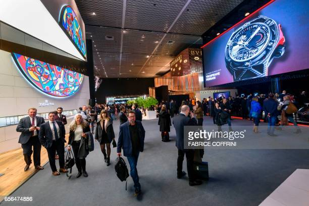 Visitors are seen during the press day of Baselworld watch and jewellery show on March 22 2017 in Basel The world's biggest watch fair will open in...