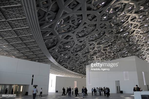 Visitors are seen during the press preview of the 'From One Louvre to Another' exhibition at the Louvre Abu Dhabi in Abu Dhabi United Arab Emirates...