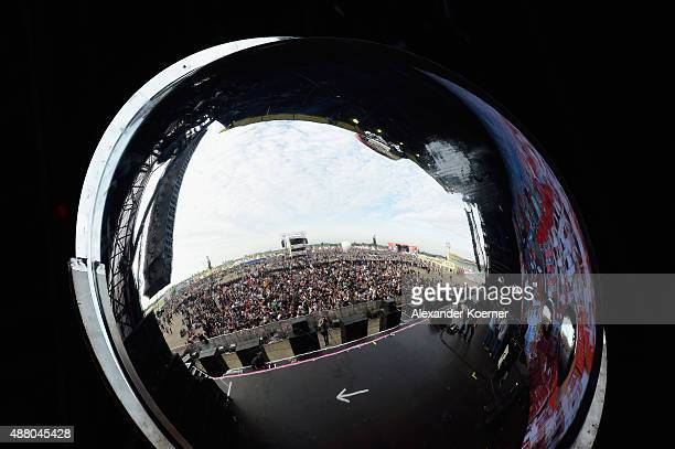 Visitors are seen in a mirror before the Beatsteaks concert during the second day of the Lollapalooza Berlin music festival at Tempelhof Airport on...