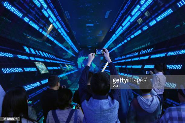 Visitors are seen in the 'time tunnel' at the big data demonstration center on April 26 2018 in Huainan Anhui Province of China