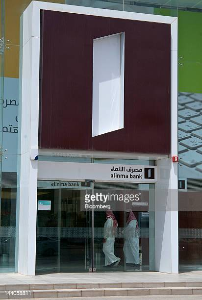 Visitors are seen inside the offices of Alinma Bank in Riyadh Saudi Arabia on Tuesday May 8 2012 Saudi Arabia's stock market is the Gulf Cooperation...