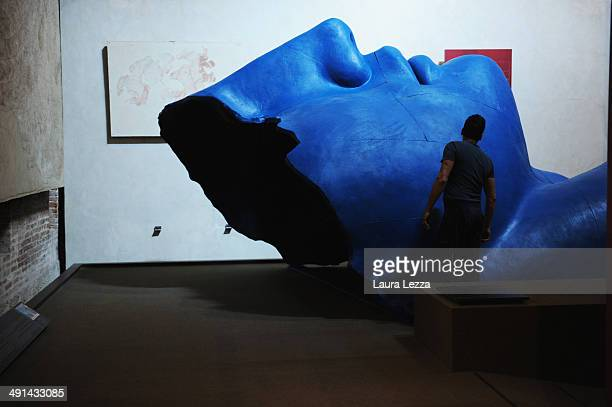 Visitors are seen near a sculpture during the opening of the Igor Mitoraj's exhibition on May 16 2014 in Pisa Italy The exhibition by Igor Mitoraj...