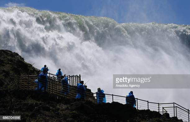 Visitors are seen on an observing tower's ladder to watch the Niagara Fall near Ontario River, in Canada, North America on May 08, 2017. Niagara...