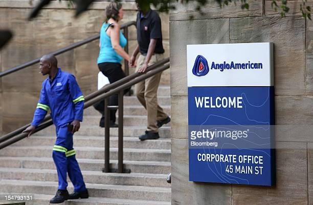Visitors are seen on steps to the offices of Anglo American Plc in the Marshalltown district of Johannesburg South Africa on Friday Oct 26 2012 Anglo...
