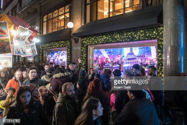 Visitors are seen outside Macy's on November 21 2017 in New York City