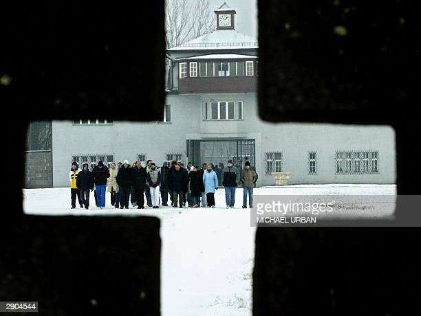 Visitors are seen through a cross in the former concentration camp Sachsenhausen 27 January 2004 in the eastern town of Oranienburg on the 59th...