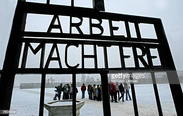 Visitors are seen through the entry of former concentration camp Sachsenhausen 27 January 2004 in the eastern town of Oranienburg on the 59th...