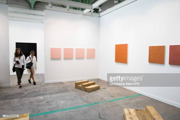 Visitors are walking next to a work of art by Marcia Hafif during the opening of the 2017 International Contemporary Art Fair at the Grand Palais on...