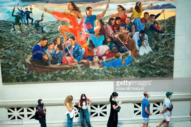 Visitors arrive as the Metropolitan Museum of Art in New York reopens to the public on August 29, 2020. - The museum closed on March 13 because of...
