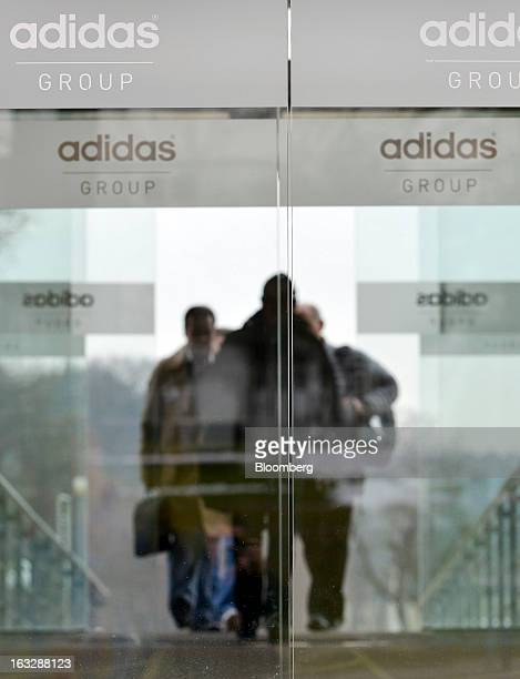 Visitors arrive at the Adidas AG headquarters in Herzogenaurach Germany on Thursday March 7 2013 Adidas AG the world's secondlargest sportinggoods...