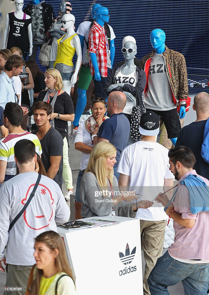 Visitors arrive at the adidas Originals Spring/Summer 13 collection at the Bread and Butter 2012 fashion trade fair on July 4, 2012 in Berlin, Germany.