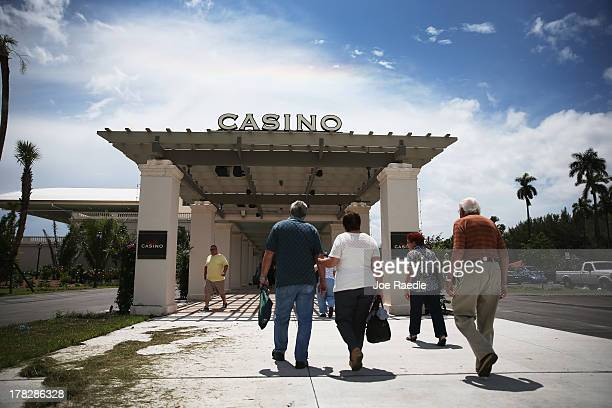 Visitors arrive at the casino that will hold its grand opening on Friday located in the Hialeah Park Race Track which first opened in 1925 on August...