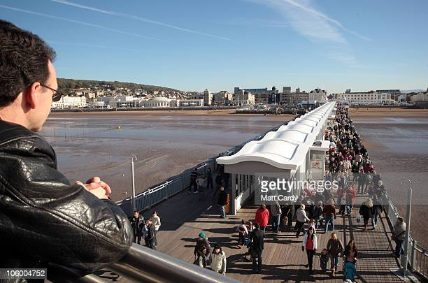 Visitors arrive at the Grand Pier on October 25 2010 in WestonSuperMare England The pier which was completely destroyed by fire in July 2008 reopened...