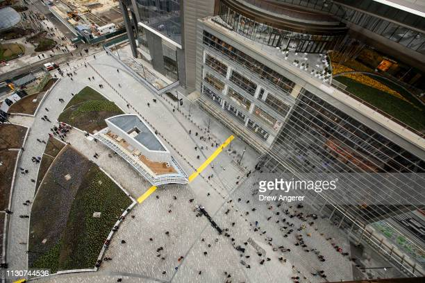 Visitors arrive at the Hudson Yards development on the opening day for phase one of the project on the West Side of Midtown Manhattan on March 15...