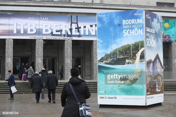 Visitors arrive at the ITB international tourism trade fair on March 7 2018 in Berlin Germany This year's ITB includes 190 countries and regions and...