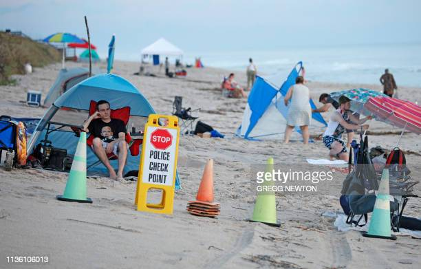 Visitors arrive early for the SpaceX Falcon Heavy rocket launch at Playalinda Beach just north of the Kennedy Space Center in Florida on April 10...