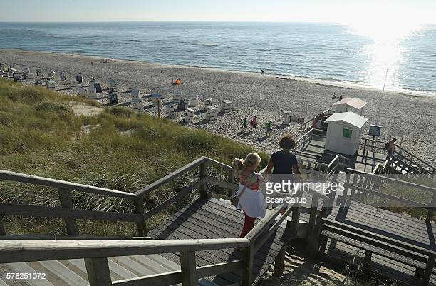Visitors arrive on a beach among on the northern end of Sylt Island on July 19 2016 near List Germany Sylt Island with its long stretches of sand...