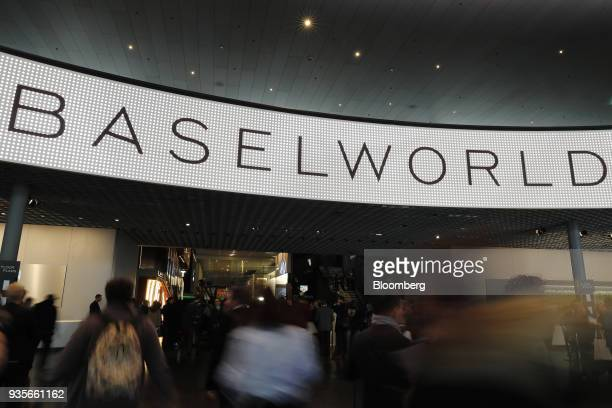 Visitors arrive on the opening day of the 2018 Baselworld luxury watch and jewelry fair in Basel Switzerland on Wednesday March 21 2018 Swiss watch...